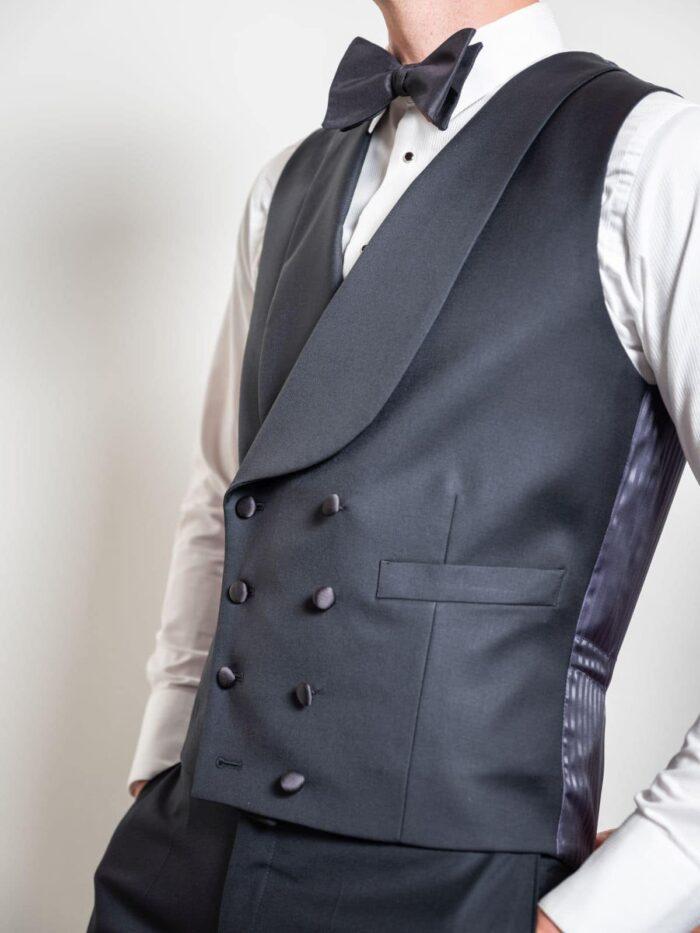Details waistcoat black tie