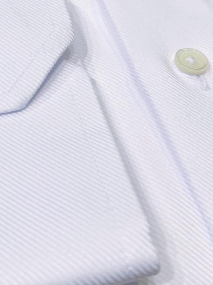 chest pocket met witte knoop